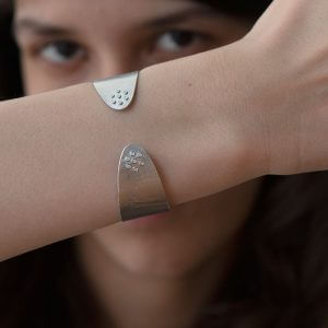 ayesha-mayadas_AMBRC020_narrow-wafer-cuff-in-sterling-silver-and-diamonds_model